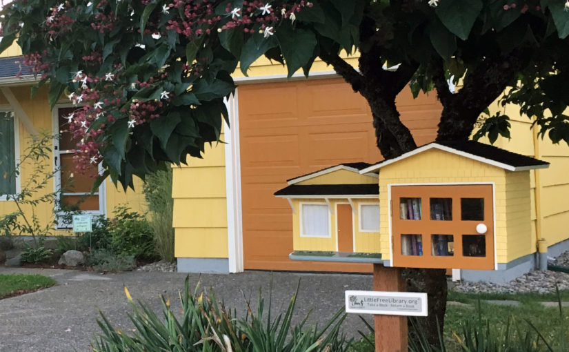 The 74th Ave Little Free Library is a model of the host house